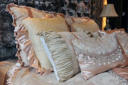 Image of comfortable pillows and bed.  photo