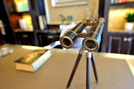 Vintage binoculars on the desk.  photo