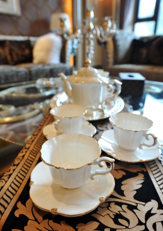 White fancy cups and teapot set. photo