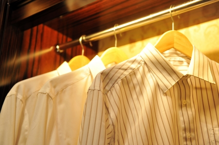 retail display: three shirts on hangers at the show. Stock Photo