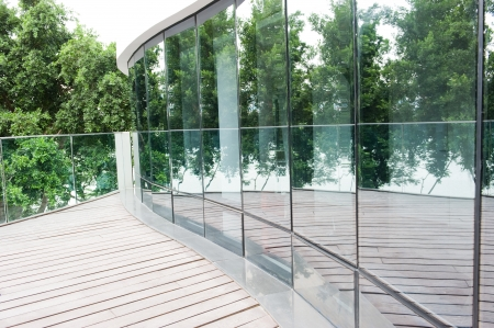 balcony: Modern office building exterior with glass wall.