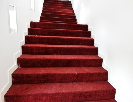 Stairs covered with red carpet. photo