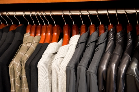 Clothes hanging in a cupboard Stock Photo - 13660651