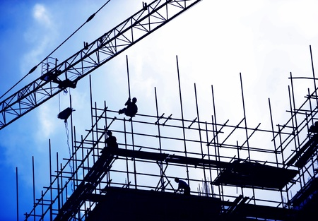 structural engineers: Construction workers working on scaffolding