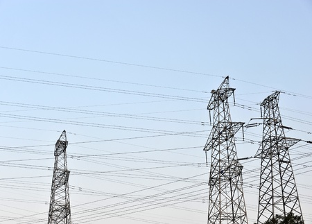 Electric power station against bright sky.  photo