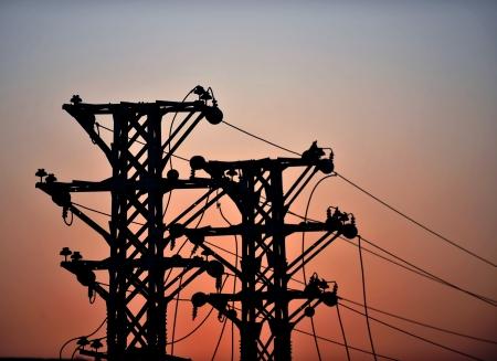 high voltage: high voltage post at sunset.