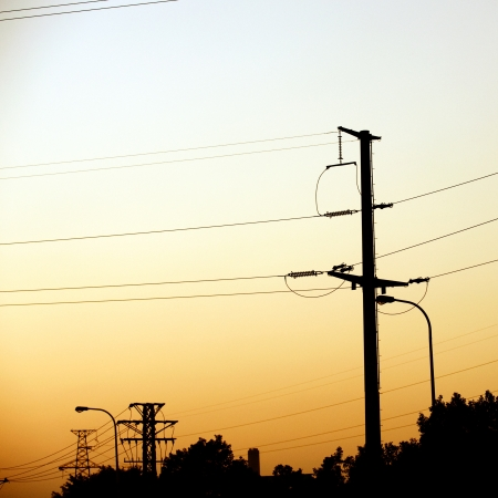insulators: high voltage post at sunset.