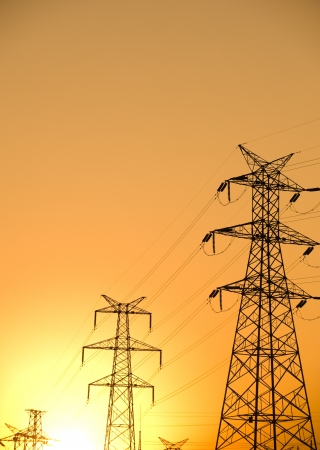 power line tower: high voltage post at sunset.