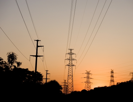 high voltage post at sunset. Stock Photo - 13693740