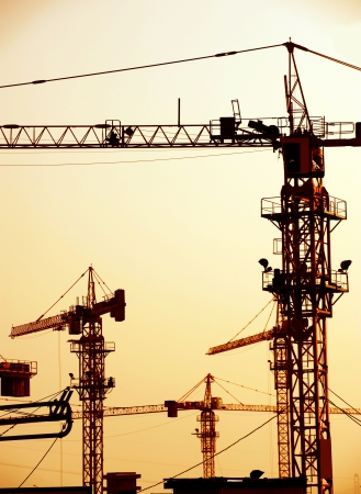 scaffold: Cranes on a construction site in China.