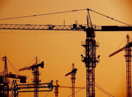 assembling: Cranes on a construction site in China.
