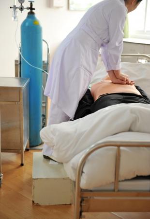 cardiopulmonary resuscitation: The man on a dummy trains to do cardiopulmonary resuscitation. Stock Photo