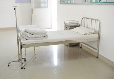 hospital bed: A hospital bed waiting the next patient.