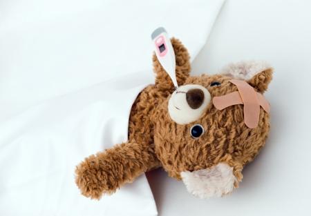 teddybear: Teddy bear ill in bed Stock Photo