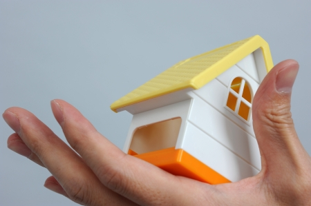 refinance: The house in human hand, real estate concept.