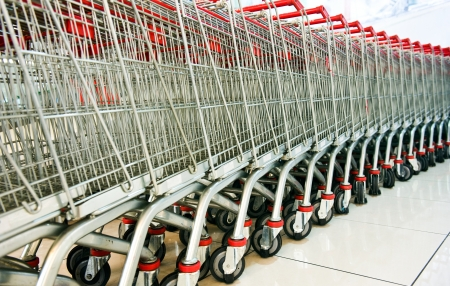 A line of shopping carts nested together  photo