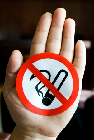 An icon showing no smoking sign in human photo