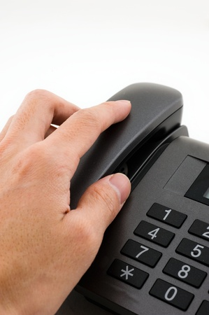 a Chinese people's hand is reaching for a phone, and the words on the telephone is Chinese. Stock Photo - 13694100