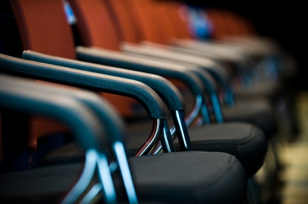 office furniture: Row of chairs in boardroom. Stock Photo