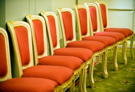 absence: Row of chairs in waiting room. Stock Photo