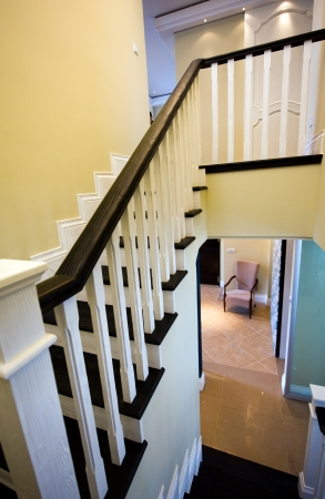 wooden staircase and bannister in a modern home.  photo