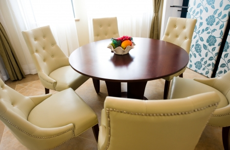 dining table and chairs: Modern dining table and chairs in dining room.   Stock Photo