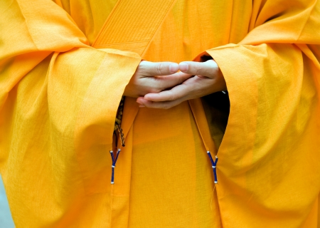 buddhism prayer belief: Chinese buddhist monk hand and fingers detail, the monk in praying.  Stock Photo