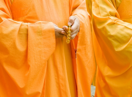Chinese buddhist monk hand and fingers detail, the monk in praying.  photo