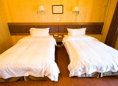 Wooden hotel room with two beds. Stock Photo - 13760876