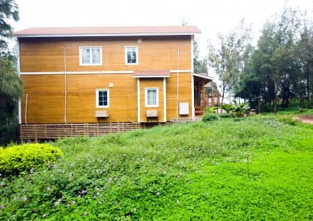 backwoods: A wooden house  with garden.