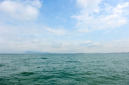 water level: green sea level and sky with slight cloud.