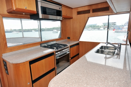 Motor yacht kitchen inside cabin.