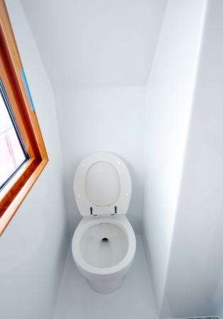 A view of a toilet in yacht. photo