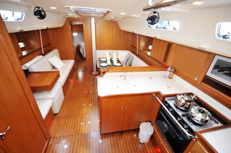 Motor yacht kitchen and living room inside cabin.