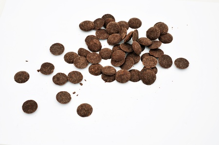Dark chocolate chips on a white background. Stock Photo - 13780270