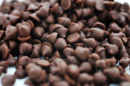 Dark chocolate chips on a white background. Stock Photo - 13780542