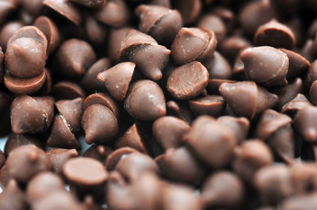 Dark chocolate chips on a white background. Stock Photo - 13780637