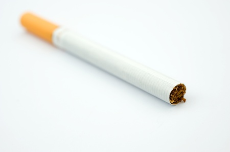 dangerous ideas: A cigarette with filter isolated on white.