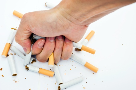 renounce: Man trying to give up smoking.  Stock Photo