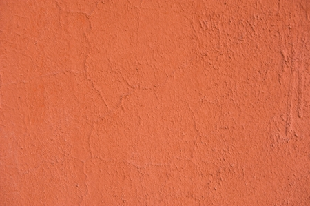 Orange color of stucco wall texture. photo