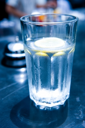 density: Glass filed with water and lemon.