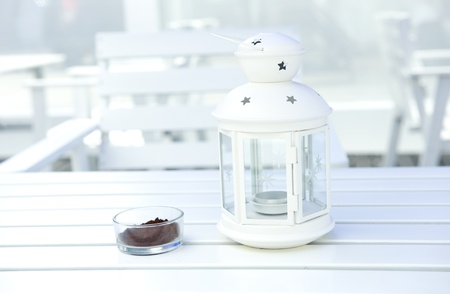 ashtray: white table with beautiful lamp and ashtray on the surface, beautiful scene of resort.