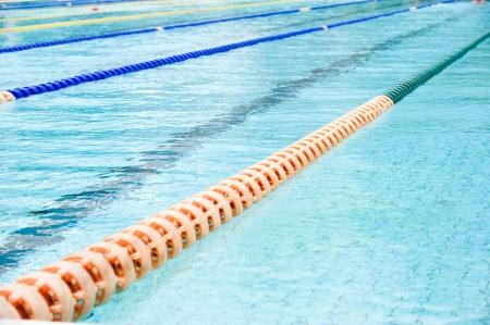 slantwise: plastic lanes in swimming pool.  Stock Photo