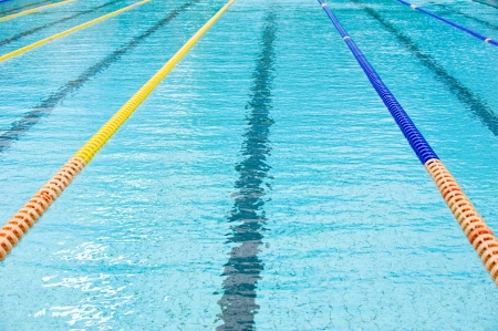swimming competition: plastic lanes in swimming pool.  Stock Photo