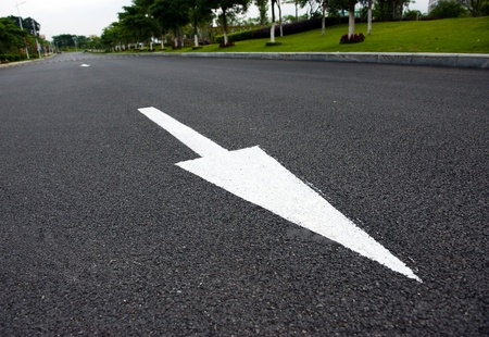road to success: Arrow on the road, concept of business vision, innovation, success.  Stock Photo