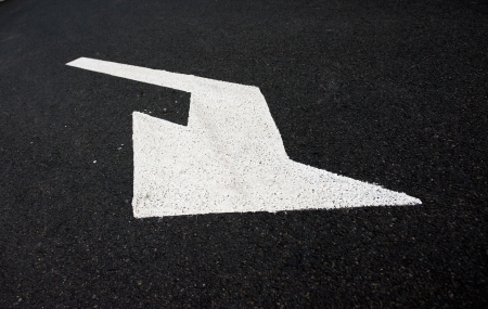 turn sign: Arrow on the road, concept of business vision, innovation, success.  Stock Photo