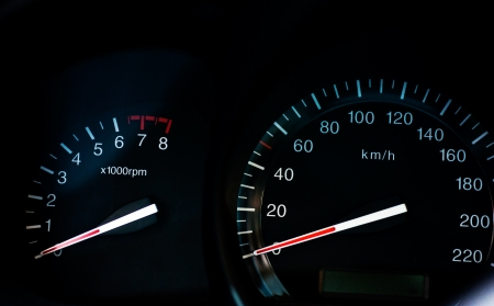 rotations: Dashboard of a sport car over black background  Stock Photo