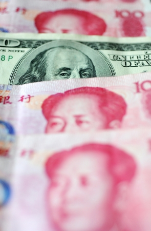 detail of us dollar and Chinese yuan , concept of exchange war  photo