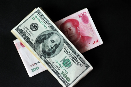 abreast: top view of green us dollar and red Chinese yuan , concept of exchange war