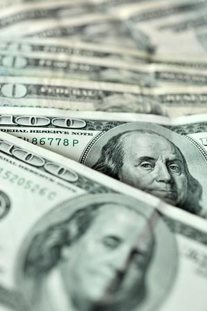 abundance money: lots of 100 US dollar bills in a line.